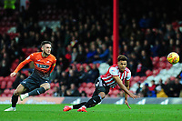 Matt Grimes of Swansea City vies for possession with Ollie Watkins of Brentford during the Sky Bet Championship match between Brentford and Swansea City at Griffin Park, Brentford, England, UK. Saturday 08 December 2018