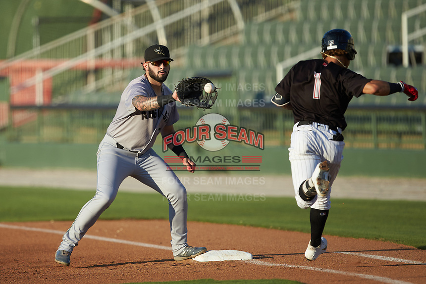Augusta GreenJackets first baseman Frankie Tostado (8) reaches for a throw as Ramon Beltre (1) of the Kannapolis Intimidators hustles down the line at Kannapolis Intimidators Stadium on June 21, 2019 in Kannapolis, North Carolina. The Intimidators defeated the GreenJackets 6-1. (Brian Westerholt/Four Seam Images)