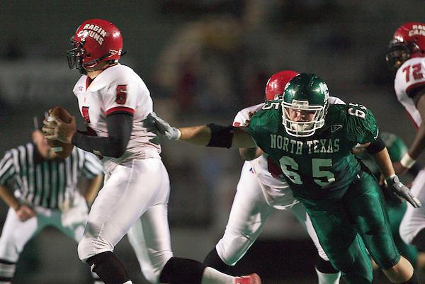 DENTON, TX  SEPTEMBER 27 :  Luke Conder #65 - North Texas Mean Green Football vs Eric Rekieta #6 - Louisiana Lafayette Ragin Cajuns at Fouts Field in Denton on September 27, 2003 in Denton, NT won 44-23. Photo by Rick Yeatts