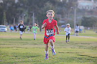 DeAnza Cove, Mission Bay, San Diego CA, USA.  Sunday, January 25 2015:  Five-year old Petia Brown completes the 1-mile kids run portion of the Friends of Pacific Beach Schools (FOPBS) School Yard Dash.  The 2nd annual charity event which raises money for the six local schools in the Mission Bay Cluster, comprised of a 1-mile run for kids followed by a 5K run for all ages.  Besides parents, teachers, staff, students and siblings competitors from all over San Diego and abroad ran in the event.  All six schools in the Mission Bay cluster had information booths at the event for potential parents to meet and speak with staff and students.  Music was provided by local teenage band Rubber Band and the string ensemble from Crown Point Elementary School.