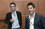 Matt McAllester, Moises Saman seen at a reception at Newsday on April 16, 2003, affirming their release from an Iraq prison. Photo by Jim Peppler.