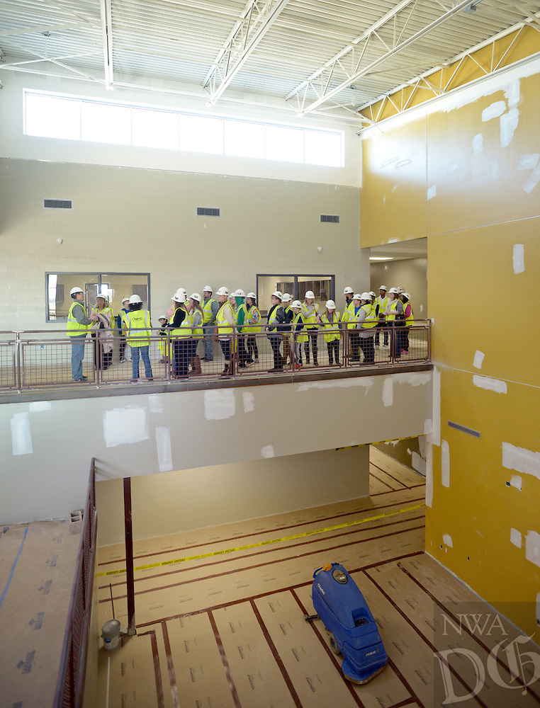 NWA Democrat-Gazette/BEN GOFF @NWABENGOFF<br /> Randall Hunt, an assistant principal at Bentonville West High School, leads a tour group on Monday Jan. 18, 2016 as school under construction in Centerton offer tours for future students and parents. Bentonville West will open it's doors for 9th-11th grade students in August.