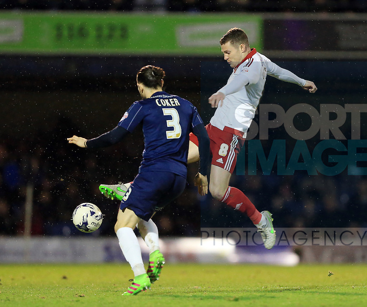 Southend's Ben Coker tussles with Sheffield United's Paul Coutts during the League One match at Roots Hall Stadium.  Photo credit should read: David Klein/Sportimage