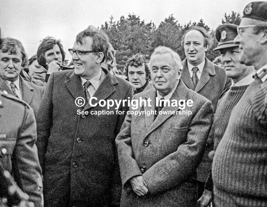 UK Prime Minister Harold Wilson at Ballykinlar Military Base, Co Down, during a 18th December 1975 pre-Christmas visit to troops serving in N Ireland. He also visited soldiers stationed in Londonderry. Immediately following his visit to Londonderry two soldiers died in a Provisional IRA bomb attack. Beside him is Merlyn Rees, Secretary of State for N Ireland (wearing glasses). Also in the picture are N Ireland-based American journalist, Peter Martin, behind Rees' right shoulder, and senior RUC officer Alfred Curral (with receding hairline behind Harold Wilson. 197512180789b<br />
