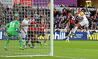 Kyle Bartley of Swansea (R) is challenged for a header by Sylvain Distin of Bournemouth during the Barclays Premier League match between Swansea City and Bournemouth at the Liberty Stadium, Swansea on November 21 2015