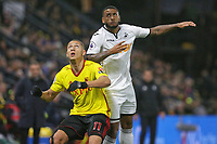 (L-R) Richarlison of Watford and Luciano Narsingh of Swansea City wait for the ball during the Premier League match between Watford and Swansea City at the Vicarage Road, Watford, England, UK. Saturday 30 December 2017