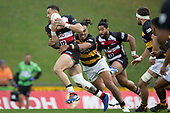 Sonny Bill Williams looks to get his arms free as Sean Wainui makes the tackle. Mitre 10 Cup rugby game between Counties Manukau Steelers and Taranaki Bulls, played at Navigation Homes Stadium, Pukekohe on Saturday August 10th 2019. Taranaki won the game 34 - 29 after leading 29 - 19 at halftime.<br /> Photo by Richard Spranger.