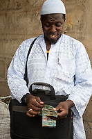 Cashew Nut Buyer Counting his Money, Fass Njaga Choi, The Gambia