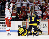Colby Cohen (BU - 25) celebrates his first goal of the night which made it 2-0 BU in the first period. - The Boston University Terriers defeated the Merrimack College Warriors 6-4 (EN) on Saturday, January 16, 2010, at Agganis Arena in Boston, Massachusetts.