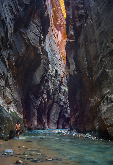 The Virgin River carves its way through The Narrows at Zion National Park, Utah