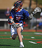 Peter Lapina #6 of Manhasset stickhandles behind the net during the 133rd Woodstick Classic against host Garden City High School on Saturday, April 28, 2018. He scored a goal to break a 4-4 tie midway through the fourth quarter to lead Manhasset to a 7-4 win.