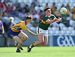 Jack Regan of Clare in action against Darragh Rahilly of Kerry during their Munster Minor football final at Pairc Ui Chaoimh. Photograph by John Kelly.