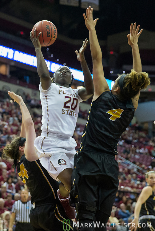 Florida State forward Shakayla Thomas shoots between Missouri guard Sierra Michaelis, left, and Cierra Porter during the second half of a second-round game of the NCAA women's college basketball tournament in Tallahassee, Fla., Sunday, March 19, 2017. Florida State defeated Missouri 77-55. (AP Photo/Mark Wallheiser)