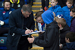 Blackburn Rovers 3 Shrewsbury Town 1, 14/01/2018. Ewood Park, League One. Home manager Tony Mowbray signing autographs for fans by the technical area before Blackburn Rovers played Shrewsbury Town in a Sky Bet League One fixture at Ewood Park. Both team were in the top three in the division at the start of the game. Blackburn won the match by 3 goals to 1, watched by a crowd of 13,579. Photo by Colin McPherson.