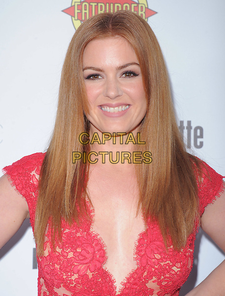 Isla Fisher.'Bachelorette' film premiere at The Arclight Theatre in Hollywood, California, USA..23rd August 2012.headshot portrait pink red lace  .CAP/DVS.©DVS/Capital Pictures.