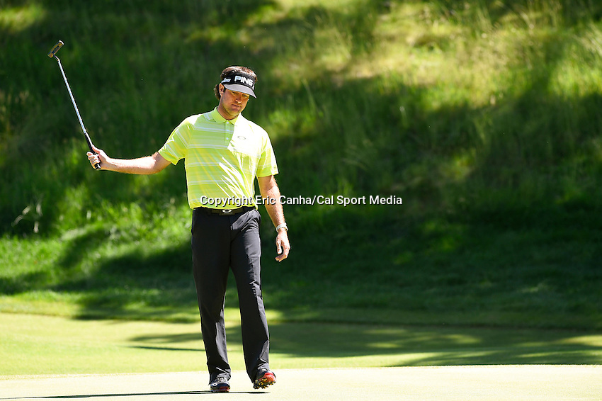 June 21, 2014 - Cromwell, Connecticut - Bubba Watson swings his putter in frustration on the 14th hole during the third round of the PGA Travelers Championship tournament held at TPC River Highlands in Cromwell, Connecticut.  Eric Canha/CSM