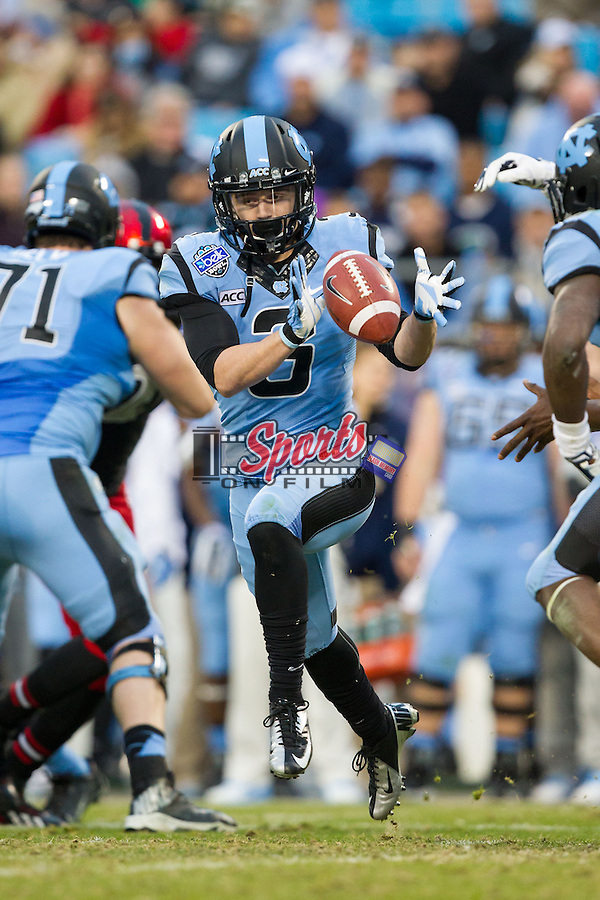 Ryan Switzer (3) of the North Carolina Tar Heels catches the ball on a reverse against the Cincinnati Bearcats in the Belk Bowl at Bank of America Stadium on December 28, 2013 in Charlotte, North Carolina.  The Tar Heels defeated the Bearcats 39-17.   (Brian Westerholt/Sports On Film)