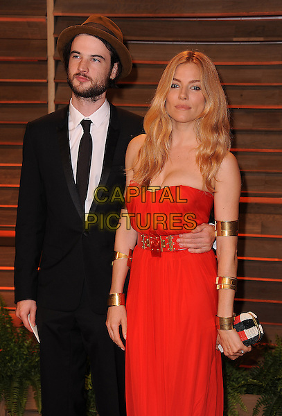 WEST HOLLYWOOD, CA - MARCH 2: Tom Sturridge and Sienna Miller arrive at the 2014 Vanity Fair Oscar Party in West Hollywood, California on March 2, 2014.<br /> CAP/MPI<br /> &copy;MPI213/MediaPunch/Capital Pictures