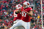 Wisconsin Badgers teammates Olive Sagapolu (99) and Alec James (57) during an NCAA College Big Ten Conference football game against the Iowa Hawkeyes Saturday, November 11, 2017, in Madison, Wis. The Badgers won 38-14. (Photo by David Stluka)