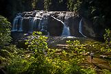 NEW ZEALAND, Greymouth, Woman admiring Coal Creek Falls, Ben M Thomas