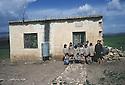 Syria 1981.A school near Afrin with the teacher and the schoolchildren.Syrie 1981.Une ecole dans la region d'Afrin avec l'institutrice et les eleves