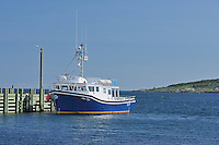Tourist boat at dock<br /> Westport on Brier Island on the Digby Neck<br /> Nova Scotia<br /> Canada