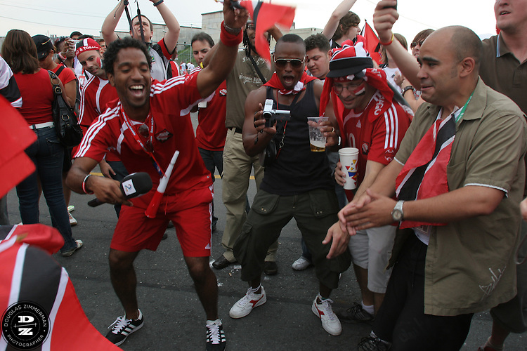 """Trinadad and Tobago National Soccer Team supporters, also known as the """"Soca Warriors""""  cheer  and dance before their nation's first round match against England at Nuremburg World Cup stadium on Thursday, June 15th, 2006. England's defeated Trinadad 2-0."""