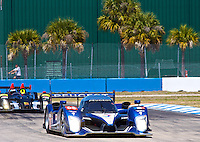 The #08 Peugeot 908 HDI FAP of Pedro lamy, Sebastien Bourdais, and Nicolas Minassian races through a turn during the mornign warmup before the 12 Hours of Sebring, Sebring, FL, MArch 20, 2010.  (Photo by Brian Cleary/www.bcpix.com)