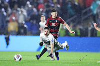 CARY, NC - DECEMBER 13: Jack Beer #11 of Georgetown University is knocked over by Cam Cilley #16 of Stanford University during a game between Stanford and Georgetown at Sahlen's Stadium at WakeMed Soccer Park on December 13, 2019 in Cary, North Carolina.