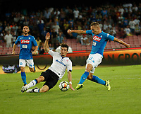 Marko Rog shoots and scores during the  italian serie a soccer match,between SSC Napoli and Atalanta      at  the San  Paolo   stadium in Naples  Italy , August 27, 2017