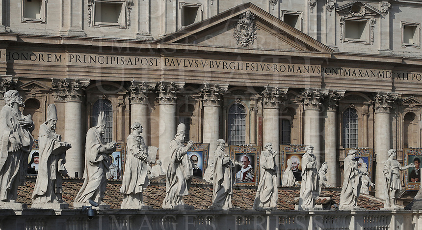 Tapestries portraying Nazaria Ignazia di Santa Teresa di Gesù March Mesa, Vincenzo Romano, Oscar Romero, Paolo Vi, Francesco Spinelli, Maria Caterina Kasper and Nunzio Sulprizio on the facade of St. Peter's Basilica on the occasion of a mass for their canonization in St. Peter's Square at the Vatican, on October 14, 2018.<br /> UPDATE IMAGES PRESS/Isabella Bonotto<br /> <br /> STRICTLY ONLY FOR EDITORIAL USE