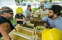 NWA Democrat-Gazette/BEN GOFF @NWABENGOFF<br /> Joson Carr helps his grandson Evan Harvey, 5, both of Gentry, make a tool box, a children's activity set up by Meek's, Thursday, July 4, 2019, during the 125th annual Gentry Freedom Fest at Gentry City Park.