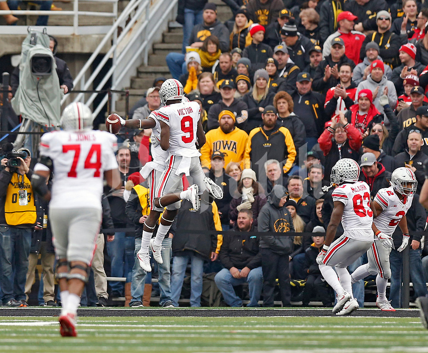 Ohio State Buckeyes wide receiver Johnnie Dixon (1) celebrates a touchdown catch with wide receiver Binjimen Victor (9) against Iowa Hawkeyes in the 2nd quarter at Kinnick Stadium in Iowa City on November 4, 2017.  [Kyle Robertson\Dispatch]