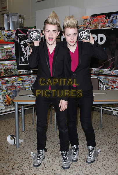 JOHN & EDWARD GRIMES aka Jedward.Attending a CD Signing, Tesco Extra Wembley, London, England, UK,  .26th July 2010..full length twins brothers family siblings silver wings trainers black suit matching purple t-shirt top jacket red pink .CAP/JIL.©Jill Mayhew/Capital Pictures