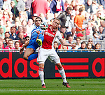 Nederland, Amsterdam, 24 augustus 2014<br /> Eredivisie<br /> Seizoen 2014-2015<br /> Ajax-PSV <br /> Karim Rekik (l.) van PSV en Kolbeinn Sigthorsson (r.) van Ajax strijden om de bal.