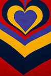 Mural of multicolored heart on side of building