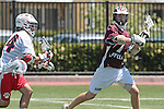 Orange, CA 05/01/10 - Nick Wilks (Chapman # 24) and Alec Paul (LMU # 7) in action during the LMU-Chapman MCLA SLC semi-final game in Wilson Field at Chapman University.  Chapman advanced to the final by defeating LMU 19-10.