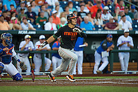 Willie Abreu (13) of the Miami Hurricanes bats during a game between the Miami Hurricanes and Florida Gators at TD Ameritrade Park on June 13, 2015 in Omaha, Nebraska. (Brace Hemmelgarn/Four Seam Images)