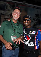 May 31, 2013; Englishtown, NJ, USA: Toyota official Keith Dahl poses with a championship ring presented to him by NHRA top fuel dragster driver Antron Brown during qualifying for the Summer Nationals at Raceway Park. Mandatory Credit: Mark J. Rebilas-