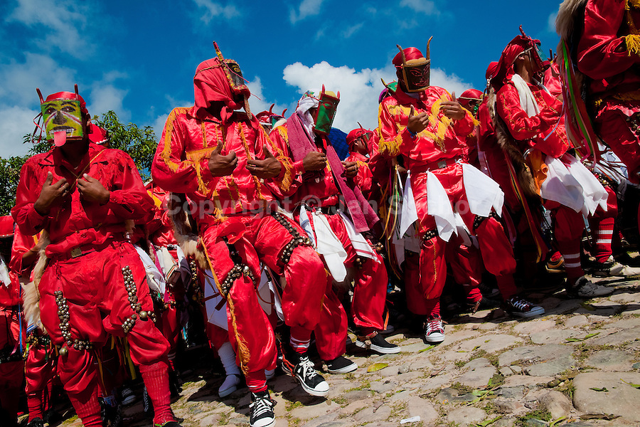 """The Devils (Diablos) dance and play castanets during the religious procession in Atanquez, Sierra Nevada, Colombia, 3 June 2010. A colorful celebration of Corpus Christi is held in the Kankuamo Indians territory every year. """"The Dance of the Devils"""" is an ancient tradition kept for centuries on the Colombia's Caribbean coast. This Christian religious event usually coincides with the summer solstice, which has always been the key point for the native cultures and for the black African slaves. Due to this confluence, the Kankuamo myths, the African animistic rites and other Pre-Columbian features have blended with the Spanish Catholic festival into a lively spectacle."""