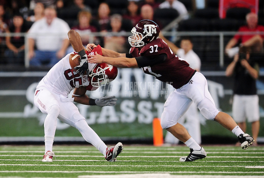 Oct. 9, 2010; Arlington, TX, USA; Texas A&M Aggies linebacker (37) Michael Hodges tackles Arkansas Razorbacks wide receiver (85) Greg Childs at Cowboys Stadium. Mandatory Credit: Mark J. Rebilas-