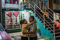 Vicky Delgadillo and Carlos Saldana stand for a portrait in front of their home in Xalapa, Mexico on November 4, 2017. <br /> Photo Daniel Berehulak for The New York Times