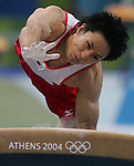 8/16/04 --Al Diaz/Miami Herald/KRT--Athens, Greece--Men's Team Final in Gymnastics Artistic at the Olympic Indoor Hall during the Athens 2004 Olympic Games. Japan's Isao Yoneda scores a 9.550 on the Vault Exercise.