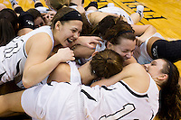 Penn players celebrate by piling up on the court after a 68-48 win against Columbus North in the IHSAA Class 4A Girls Basketball State Championship Game on Saturday, Feb. 27, 2016, at Bankers Life Fieldhouse in Indianapolis.