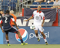 D.C. United midfielder Kyle Porter (19) controls the ball. In a Major League Soccer (MLS) match, the New England Revolution (blue) tied D.C. United (white), 0-0, at Gillette Stadium on June 8, 2013.