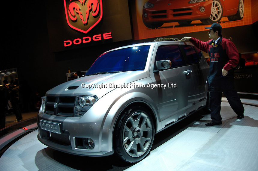 A man cleans a Dodge concept car HORNET at the 2006 International Automotive Exhibition in Beijing, China..25 Nov 2006