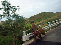 "North Korean in the North Korean country-side look worn out and tattered. North Korea is one of the last great dictatorships where, ""Our Dear Leader"" Kim-Jong-il and his father Kim Il-sung ""The Great Leader"" are worshipped and there is complete control of people who are constantly reminded of the evil deeds of the the west and USA."