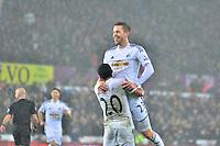 Pictured: Friday 26 December 2014<br /> Re: Premier League, Swansea City FC v Aston Villa at the Liberty Stadium, Swansea, south Wales, UK.<br /> <br /> Swansea's Gylfi Sigurdsson celebrates scoring his goal