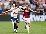 West Ham's Javier Hernandez tussles with Tottenham's Harry Winks during the premier league match at the London Stadium, London. Picture date 23rd September 2017. Picture credit should read: David Klein/Sportimage
