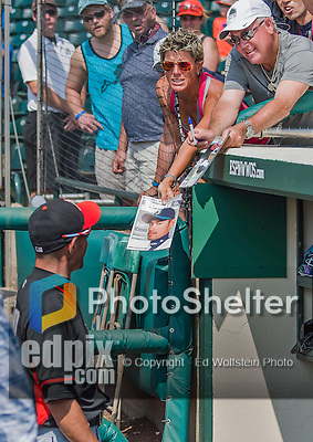 19 March 2015: Miami Marlins outfielder Ichiro Suzuki looks at the cover of a Sports Illustrated magazine with his image shown to him by a fan prior to a Spring Training game against the Atlanta Braves at Champion Stadium in the ESPN Wide World of Sports Complex in Kissimmee, Florida. The Braves defeated the Marlins 6-3 in Grapefruit League play. Mandatory Credit: Ed Wolfstein Photo *** RAW (NEF) Image File Available ***